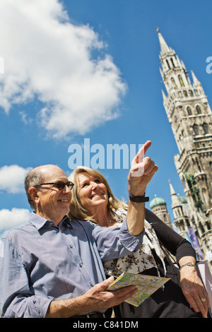Older couple using city map - Stock Photo