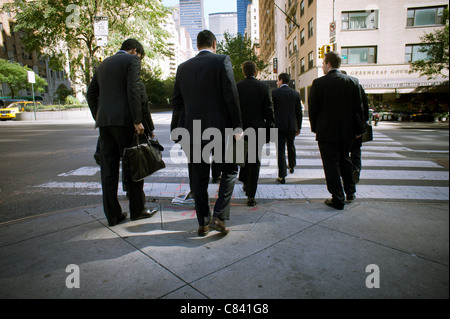 Businessmen cross an intersection in New York on Friday, October 7, 2011. (© Richard B. Levine) - Stock Photo