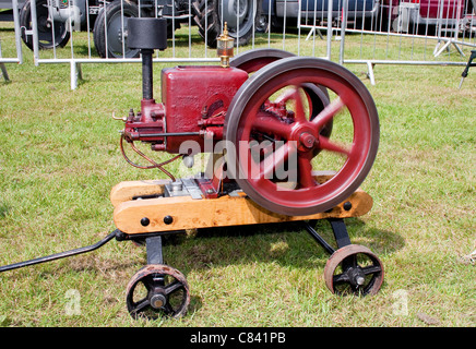Vintage Restored Red Stationary Engine with Spinning Flywheel - Stock Photo