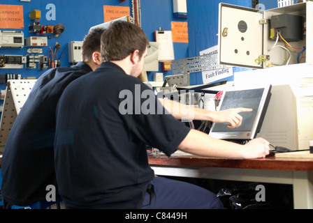 Electrical engineers working on computer - Stock Photo