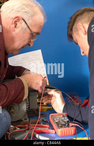 Electrical engineers working in shop - Stock Photo