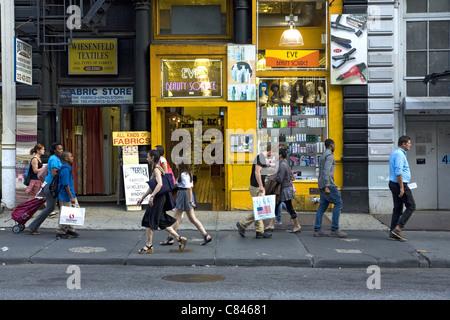 Shoppers along Broadway in the SOHO neighborhood of NYC. - Stock Photo
