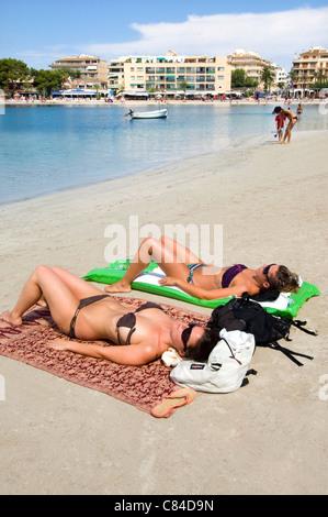 Mallorca, Port de Alcudia, beach, sunbathers, bikinis - Stock Photo