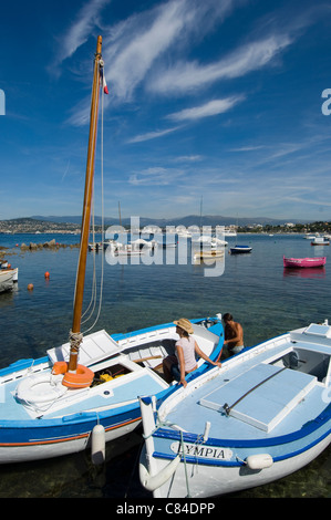 Cap d'Antibes, couple setting off sailing - Stock Photo