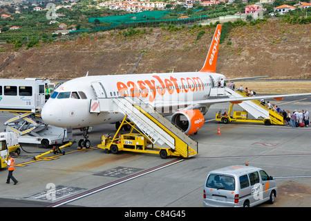 Passengers boarding EasyJet plane at Funchal airport Madeira Portugal EU Europe - Stock Photo
