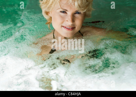 Woman relaxing in spa jacuzzi - Stock Photo