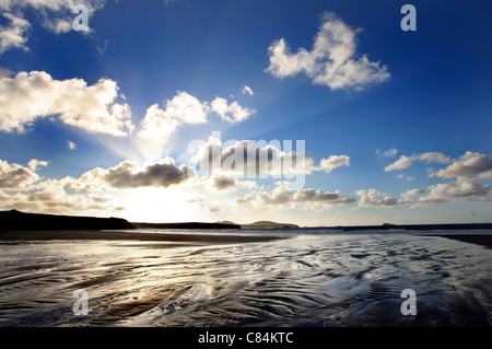 The sun setting over Whitesands Bay near St. Davids in Pembrokeshire, West Wales. - Stock Photo