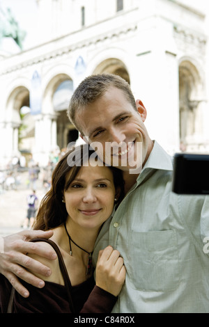Couple posing for picture outdoors - Stock Photo