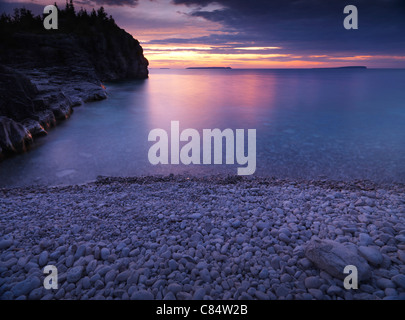 Beautiful sunset scenery of Georgian Bay rocky shore. Bruce Peninsula National Park, Ontario, Canada. - Stock Photo