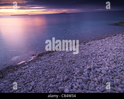 Beautiful sunset scenery of Georgian Bay pebble shore. Bruce Peninsula National Park, Ontario, Canada. - Stock Photo