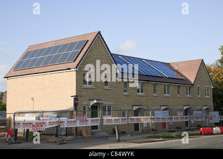 Bath, Somerset, England, UK, Britain. Solar panels being installed on the roofs of Lovell new build houses