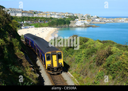 A train leaving st.ives in cornwall, uk - Stock Photo