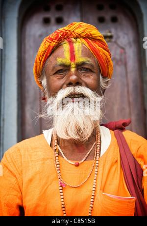 A sahu poses for the camera in Durbar Square, Kathmandu, Nepal, Asia - Stock Photo