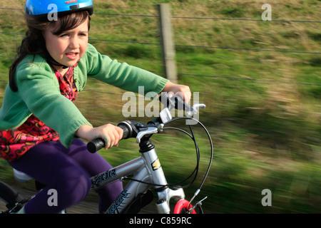 Child enjoying the fresh air on a bike - Stock Photo