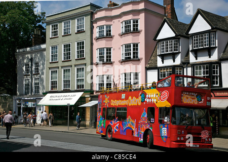 A City of Oxford tour bus taking visitors around the sights of the famous university town - Stock Photo