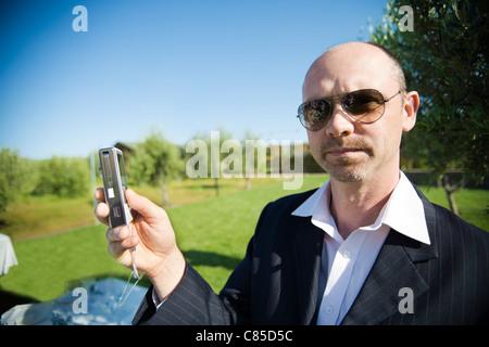 Man taking Pictures at Wedding