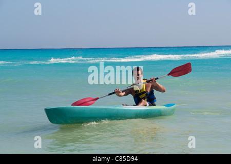 Man Kayaking, Reef Playacar Resort and Spa, Playa del Carmen, Mexico
