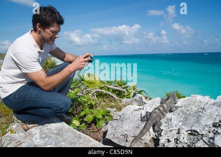 Man Taking Picture of Iguana, Reef Playacar Resort and Spa, Playa del Carmen, Mexico
