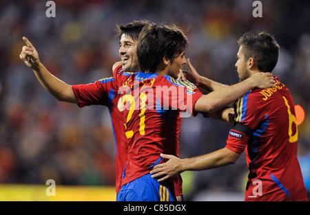 David Villa (ESP,left) ) celebrates his goal with David Silva (ESP) and Jordi Alba (ESP,right) during the Euro 2012 - Stock Photo