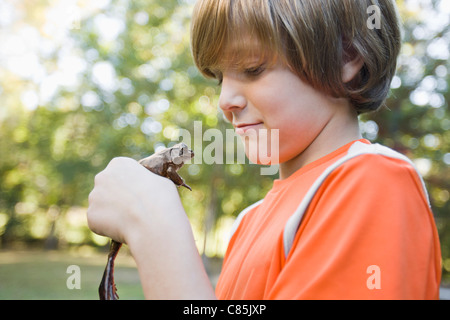 Boy Holding Frog - Stock Photo