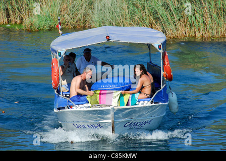 AKYAKA, TURKEY. A pleasure boat taking holidaymakers along the Azmak river in the Gokova conservation area. 2011. - Stock Photo