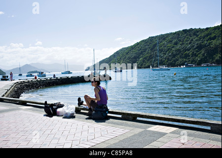 Holidaymakers and Tourists Enjoying Sunshine on a Small Pier into Queen Charlotte Sound Picton South Island New - Stock Photo