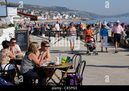 Holidaymakers at Lyme Regis a popular seaside resort in Dorset England UK - Stock Photo