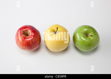 three different types of apples on white - Stock Photo