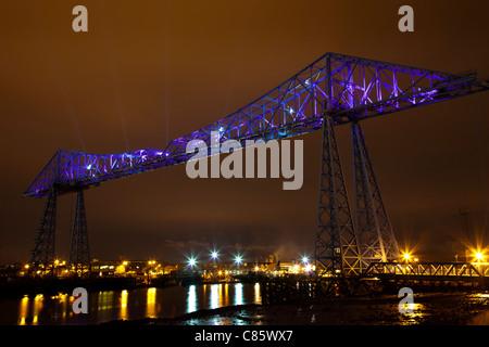 100-years-old Celebration; Teeside Transporter Bridge,illuminated at night over River Tees, Middlesbrough, Teeside, - Stock Photo