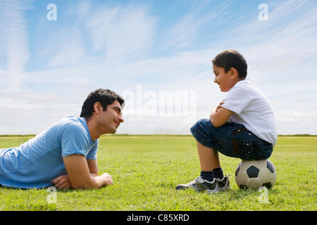 Father and son looking at each other - Stock Photo