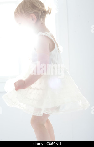 Little girl in white dress - Stock Photo