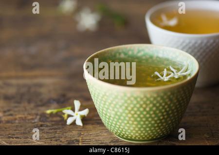 Close up of jasmine tea in teacup - Stock Photo