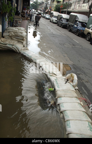 Floodwaters on street in bangkok , Thailand - Stock Photo