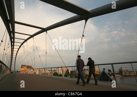 Pedestrian bridge over the Rhine between Germany and France near Basel, Switzerland. - Stock Photo