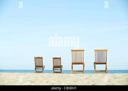 Lounge chairs on beach - Stock Photo