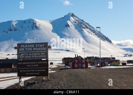 Warning sign for tourists and visitors at the international scientific research base of Ny Alesund, Svalbard. - Stock Photo
