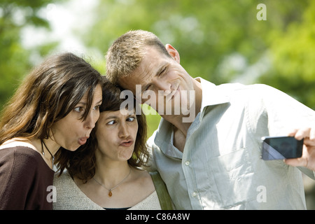 Friends making funny faces for photo - Stock Photo