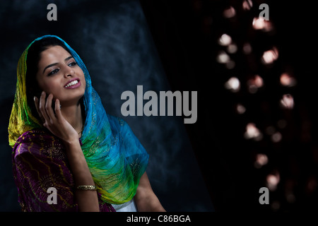 Muslim woman talking on the phone - Stock Photo