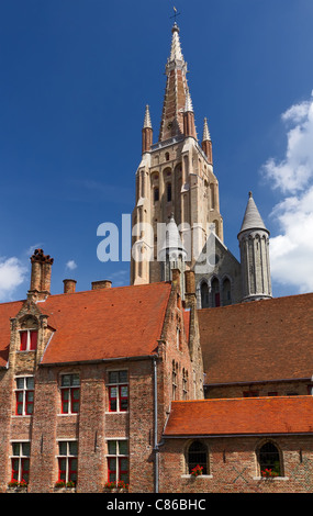 The spire of the Church of Our Lady in Bruges, Belgium - Stock Photo