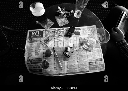 Pub table during the Grand National horse race at Aintree, Liverpool 2011 - Stock Photo