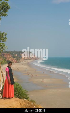 VARKALA: PAPANASAM BEACH AND INDIAN GIRL ON CLIFFTOP - Stock Photo