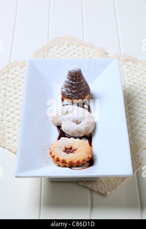 Homemade Christmas cookies on a white ceramic plate - Stock Photo