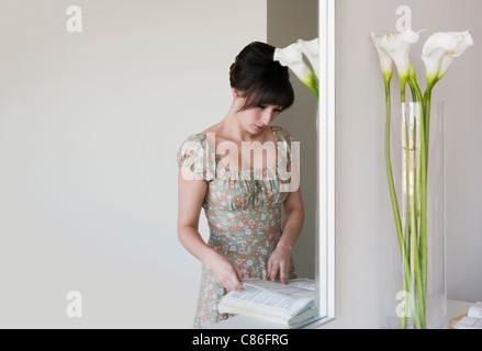 Woman reading music book - Stock Photo