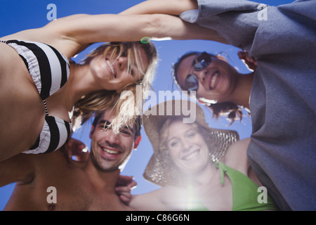 Friends hugging in a circle - Stock Photo