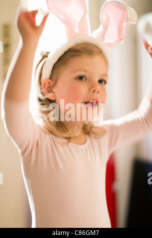 Girl wearing bunny ears - Stock Photo