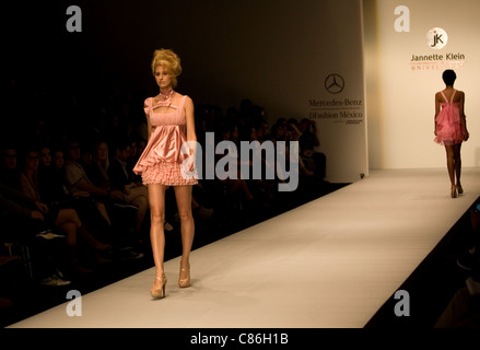 Models wearing a desing by Jannette Klein university students walks along the catwalk during Mexico City Fashion - Stock Photo
