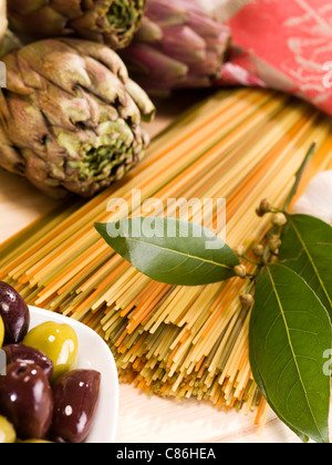 Close up of artichokes, pasta and olives - Stock Photo