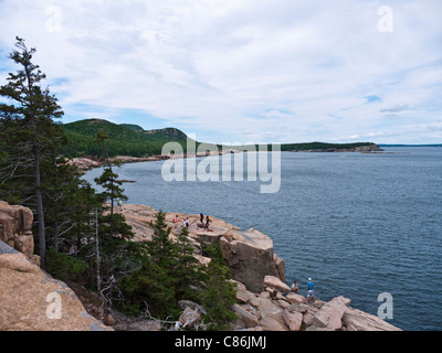 Rock climbers at otter cliffs in arcadia national park me usa rock climbers at otter cliffs with a view to great head in arcadia national park me sciox Choice Image