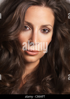 Portrait of a beautiful woman with long brown hair - Stock Photo