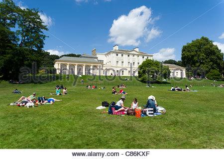 People having picnics on the grounds of Kenwood House, Hampstead Heath, London, England, UK - Stock Photo